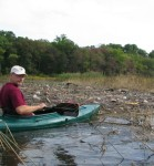 Bill Schramm points out a garbage dump that doesn't belong there.