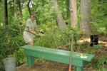 Frank Eggert prepares plantings around a new bench overlooking the Glen Dam.