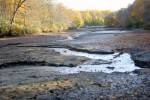 A partly-drained Wenonah Lake reveals the meandering stream that feeds it.  The lake was drained so the swimming area could be dredged. 