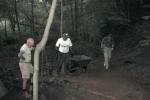 Berm builders (l-r) Frank Eggert, Bob Bevilacqua, and Rich Dilks ponder how to best direct Marion Avenue runoff away from the Monongahela Brook Trail.