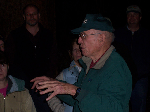 Senior Trailmaster Frank Eggert welcomes the assembled hikers on an unusually warm (55 degree) January evening.
