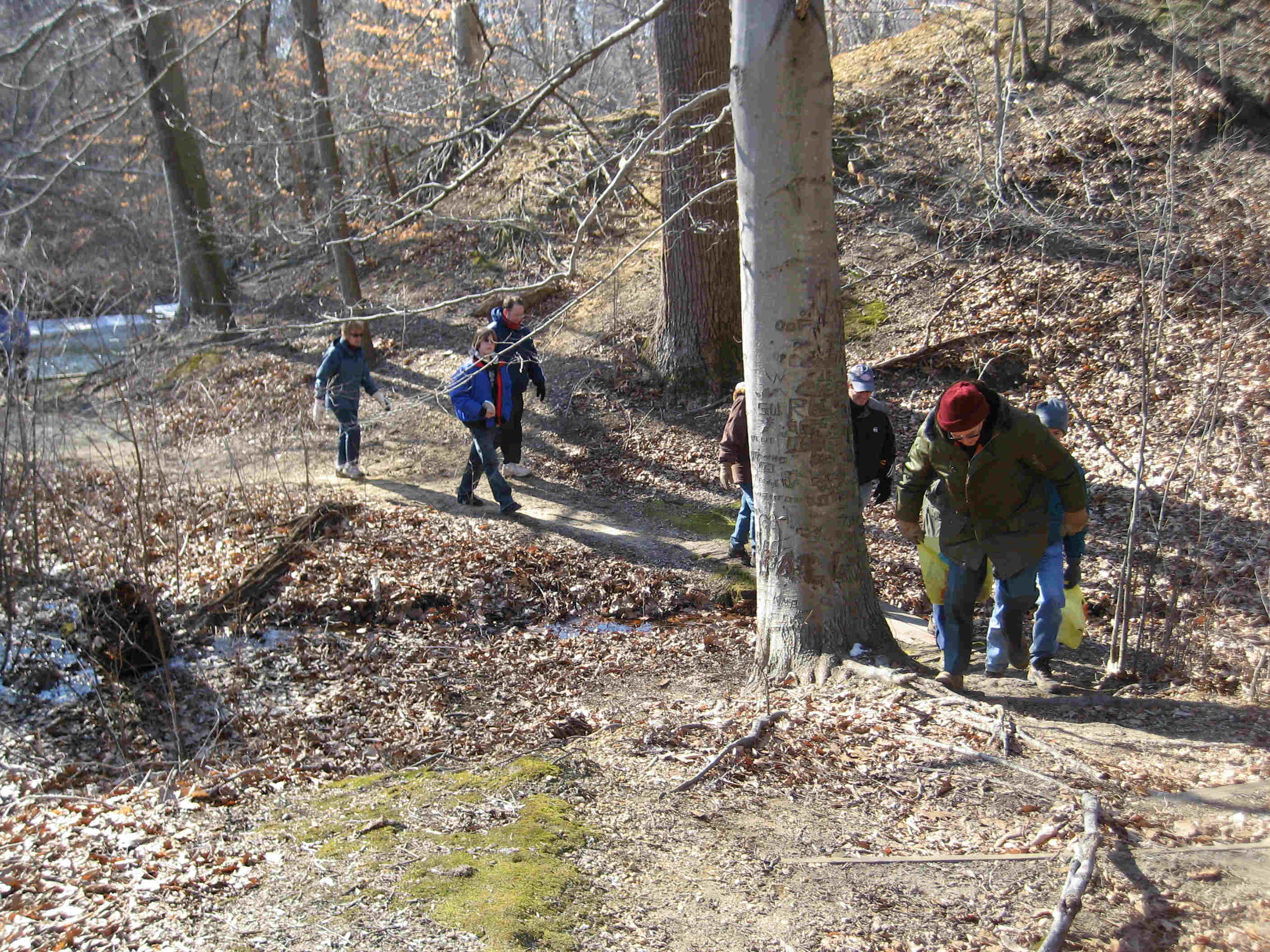 Hikers climb up away from the creek just south of Clay Hill.