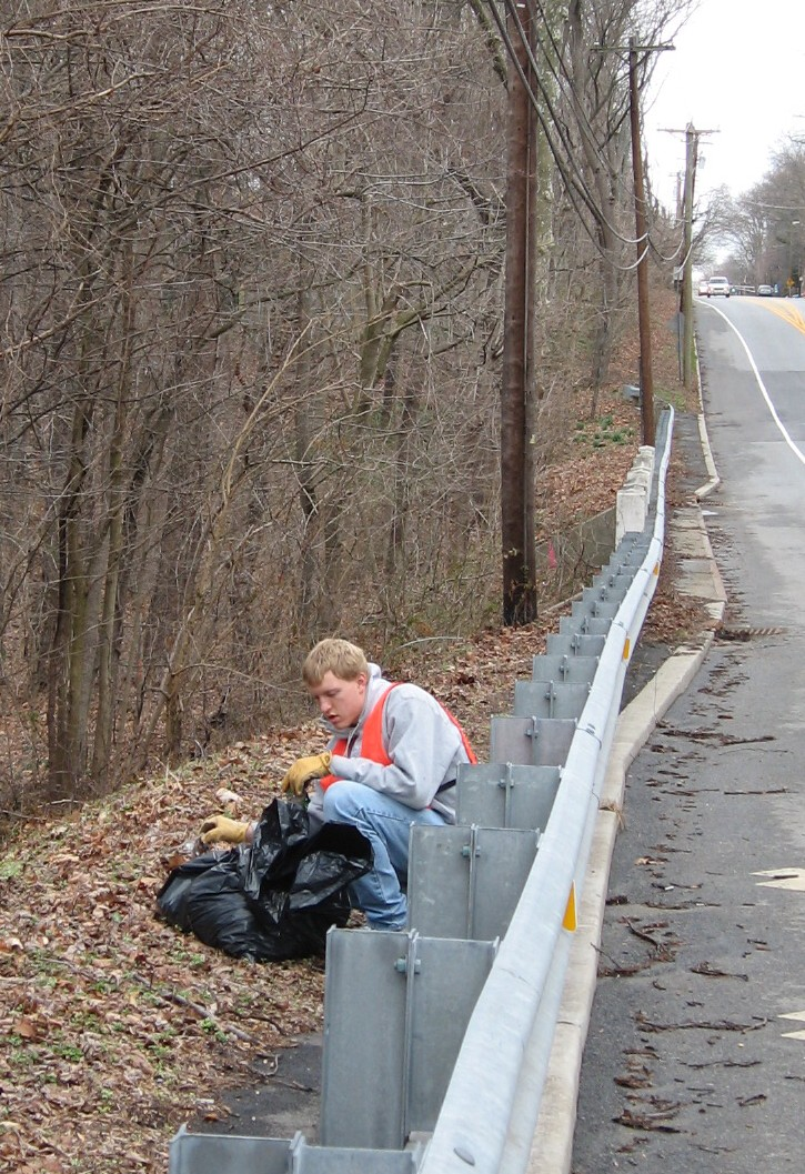 Chris Mayer helps clean up the WEC's adopted roadway: Woodbury-Glassboro Road.