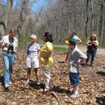 Rich Dilks (left) points out local plant life to hikers during the first WEC Spring Hike on April 22nd.