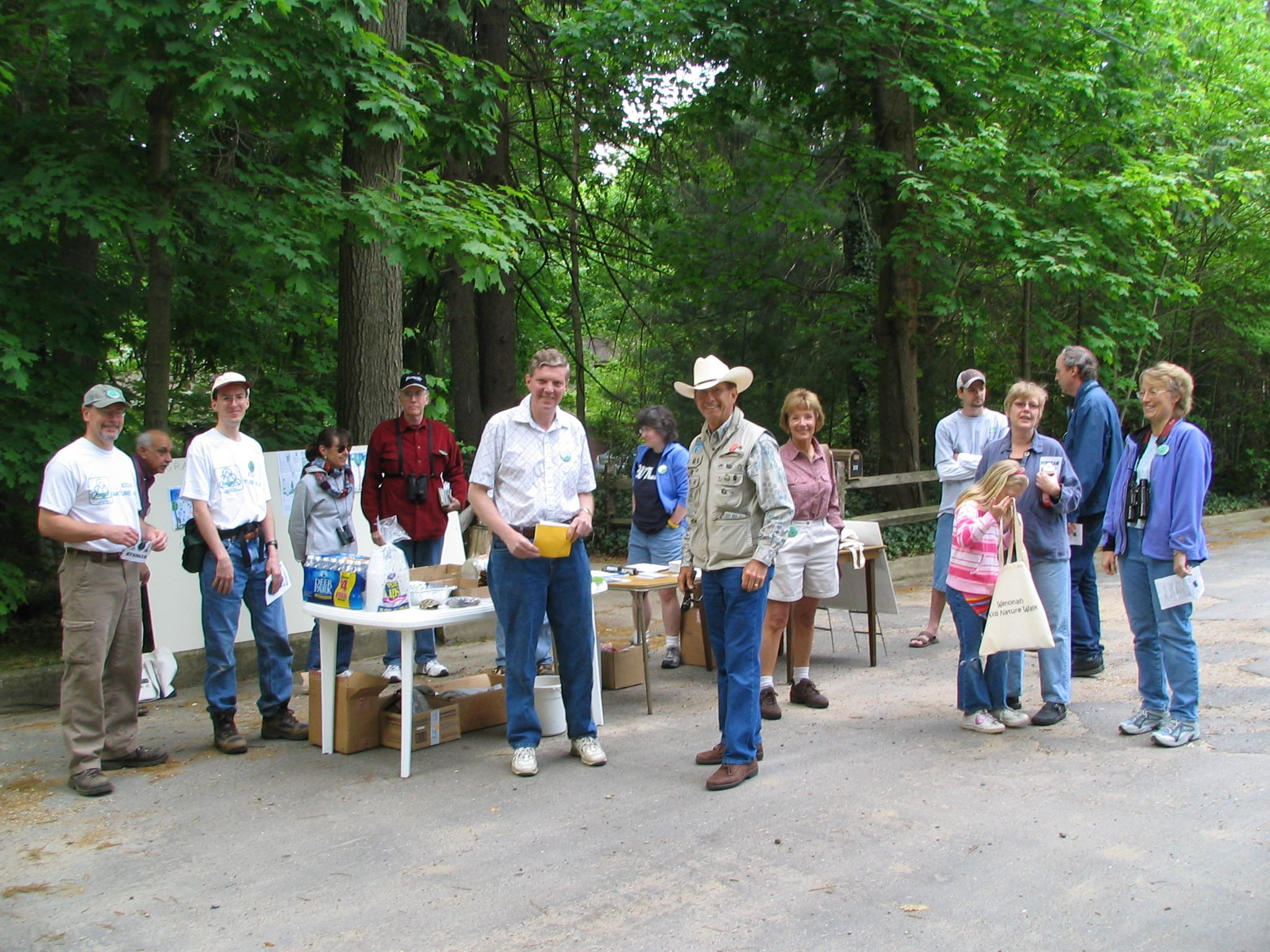 The hike guides gather at the registration table, bright and early.