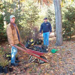 From the November 4th work party: John Forren and John Sakoff help tote some of the 300 donated trees and shrubs from streetside down to the pond area.