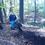 Mike Feeney and others distribute mulch around the new pond trail.