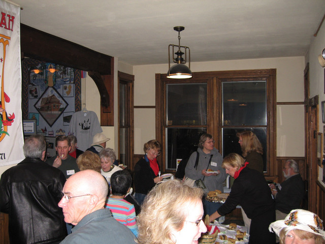 The crowd enjoyed a light buffet and desserts.