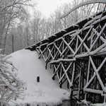 The Mantua Creek railroad trestle just after a storm