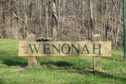 Sign welcoming visitors to Wenonah at the entrance to Breakback Run Trail near Wenonah Lake